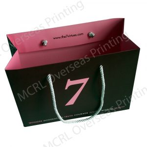 an empty paper bag with a color of pink inside and black from outside and a number 7 at the middle